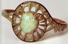 A bracelet by Georges Fouquet.  I have at present no evidence to support it, but I wonder if this isn't a ring--that would have to be one might opal if it's really a bracelet.