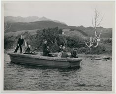 President Roosevelt and his party embark on a trout fishing expedition on Buskin Lake, Kodiak Island, Alaska, August  7, 1944.