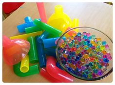 funnels and tubes with water beads. i like the idea of having something to do with them...other than just love them!