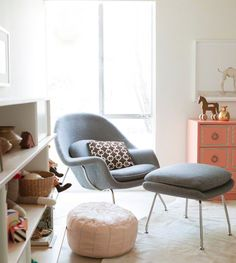 Womb chair, great for nursing and beautiful design... perhaps it come in a rocker... love Eames rockers but the plastic is difficult for me to get comfortable in, or hold twins in.