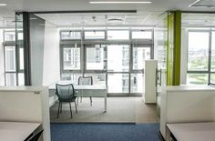 Slick all White Office Interior with a POP of colour by @fsgafrica