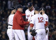 CrowdCam Hot Shot: Boston Red Sox starting pitcher John Lackey is relieved by manager John Farrell in the 7th inning against the St. Louis Cardinals during game six of the MLB baseball World Series at Fenway Park. Photo by Robert Deutsch