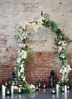 industrial greenery and lantern wedding arch