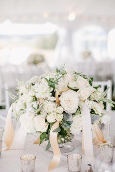Elegant white floral centerpiece: http://www.stylemepretty.com/maryland-weddings/baltimore/2016/03/24/classic-elegant-maryland-horse-farm-wedding/   Photography: Shannon Michele - http://shannonmichelephotography.com/
