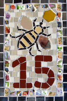 House Number 15 (Bee) Unglazed ceramic and vitreous glass tiles, vintage crockery, mirror TomatoJack Arts