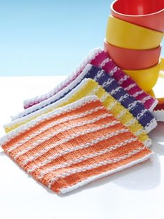 "The perfect beginner dishcloth that mixes rows of stockinette and garter to achieve a ""classic beach towel"" look. #knit #stripes #brights"
