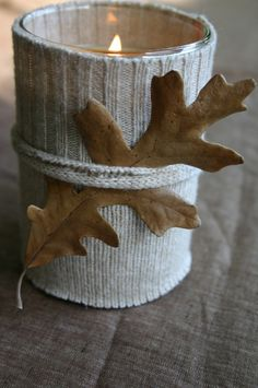 Use a sweater or an odd sock to cover a cozy votive for an autumnal accent. From cfabbridesigns.com.