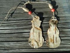 Two very rustic snowman ornaments made out of birch bark, $8.00