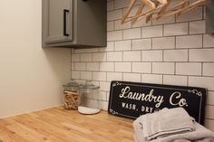Modern Farmhouse Laundry Room Reveal | ORC Week 6 - Gather and Flourish White Laundry Rooms, Mudroom Laundry Room, Laundry Room Signs, Farmhouse Laundry Room, Laundry Room Organization, Laundry Folding Station, Unfinished Cabinets, Challenge Week, Flourish