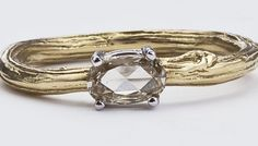 $1290 rose cute diamond twig ring.   and I don't even normally like yellow gold.