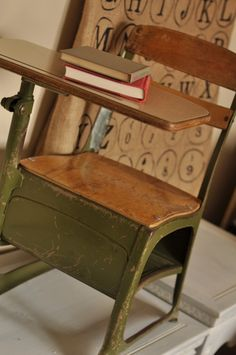 grade school desk with a place to keep books under the seat