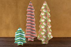 #Three #Dimensional #Holiday #Tree #Centerpieces. They made from paper and easy to assemble and  would be a lovely addition to your holiday table.