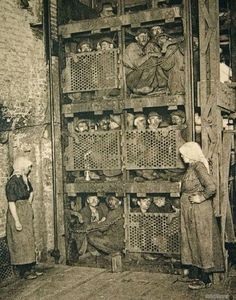 Belgian miners on their way down into the mine, 1900