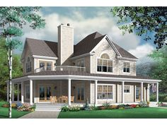 Greenfield Farm Country Home Inviting Farmhouse Has A Balcony Above The Wrap-Around Porch from houseplansandmore.com
