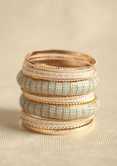Treasured Moment Bangle Set In Mint 16.99 at shopruche.com. Finished in hues of gold, mint, and ivory, the ornate bangles in  this set of thirteen can be worn separately or all at once for a variety  of stylish looks.2.75