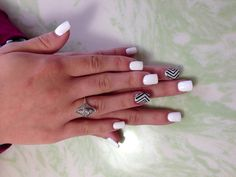 instead of all white nails, do white tips with silver underline to pull the silver out of the one nail!