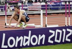 Britain's Andrew Pozzi stops after knocking down a hurdle in a men's 110-meter hurdles heat during the athletics in the Olympic Stadium at the 2012 Summer Olympics, London, Tuesday, Aug. 7, 2012.