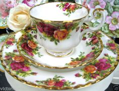 ROYAL ALBERT TEA CUP AND SAUCER TRIO OLD COUNTRY ROSES