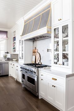 classic white kitchen with brass accents  Read More on SMP: http://www.stylemepretty.com/living/2016/06/09/double-kitchen-islands-weve-died-and-gone-to-heaven/