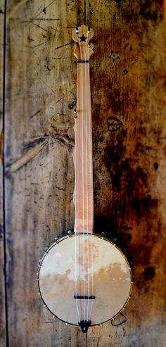 This is my seventh banjo. Birch neck, Pine Ring. Pegs, bridge, nut and tailpiece all made of ebony. Black walnut star inlay. Hand made brass tension hoop holds down a beautiful J. D. Balch goat skin hide. Nylgut strings. Poppa Mack Banjos. B7-2015.