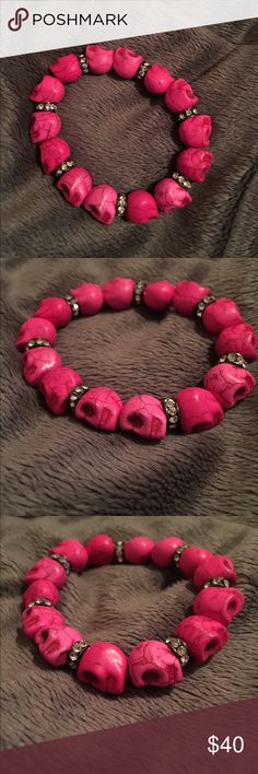 Handmade bright pink skull bracelet Handmade bright pink skull bracelet with rhinestone inserts throughout. Perfect for any skull lover or trendy fashion girl. The bracelet stretches for fit. Jewelry Bracelets