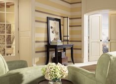 Benjamin Moore offers interior paint in a variety of colors for your living room.  Benjamin Moore:  ticonderoga taupe  992  vellum  207  albescent  OC-40  Accent Colors  weekend getaway  473