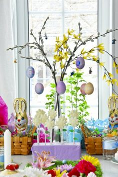 Easter centerpiece hung with blown eggs- an easy and inexpensive DIY.
