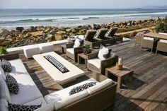 Modern patio features a modern outdoor sofa with chaise lounge facing a modern long fire pit. Modern Outdoor Sofas, Small Outdoor Spaces, Outdoor Living Rooms, Modern Patio, Outside Living, Outdoor Chairs, Living Spaces, Fire Pit Furniture, Outdoor Furniture Sets