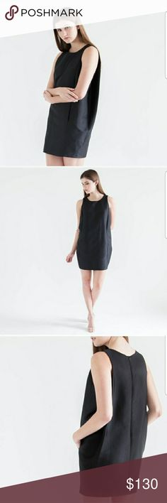 Black Structured Dress by FRNCH This is a black structured cocoon dress. It has an elegant look and feel to it. Pair with simple heels.and turn heads when walking in to a room in this dress. Also has pockets! FRNCH Dresses