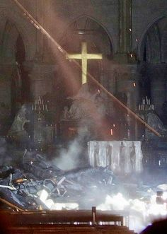 Smoke rises around the altar in front of the cross inside the Notre Dame Cathedral as a fire continues to burn in Paris Altar, Monuments, Cathedral Church, I Love Paris, Historical Images, Place Of Worship, France Travel, Our Lady, City Lights