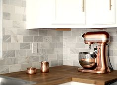 You can incorporate your countertop appliances into your kitchen décor, leaving your counters looking pretty without sacrificing function. Here is how.