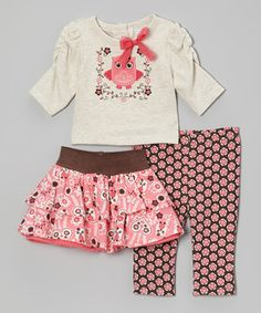 Once upon a time, outfits were specially crafted for sweet darlings—and luckily that time is now! This charming ensemble will enchant little ones with its pretty fluttery skirt and comfy matching top and leggings.