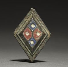 Ornamental Brooch, c. 100-300 Gallo-Roman or Romano-British, Migration period, 2nd-3rd century  bronze and champlevé enamel, Overall - h:5.40 w:3.80 d:2.38 cm (h:2 1/8 w:1 7/16 d:7/8 inches). Purchase from the J. H. Wade Fund 1930.231 Cleveland Museum of Art