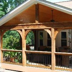 Open Porch with cedar arches and TimberTech Composite Decking with Aluminum Balusters in Birmingham, AL