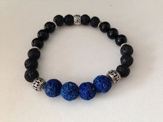 Men's bracelet, blue and black lava stone and black onyx beads, healing stones, healing jewelry on Etsy, $30.87 CAD