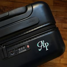Personalized luggage w/ phone charger from AWAY