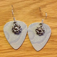 Rocking Card Jewelry prides itself on creating guitar pick jewelry out of recycled gift cards, debit cards, and credit cards. This particular piece includes guitar picks created from credit cards and flower charms.