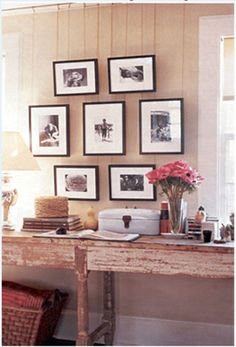 Love this idea!  Hanging pictures on wires from rails instead of nailing them to the walls.