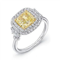 2.02ct Fancy Yellow Cushion Diamond Ring: This platinum engagement ring features a center set with a 2.02ct cushion-cut fancy yellow diamond in 18k yellow gold prongs, accented by 2 half moon sides of