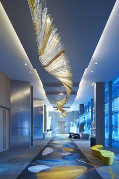 Blue and yellow at Sofitel Dubai Hotel by Wilson Associates Dubai Hotel, Dubai Uae, Hotel Restaurant, Restaurant Design, Interior Lighting, Lighting Design, Lobby Interior, Luxury Lighting, Industrial Lighting