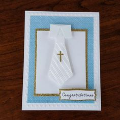 Boy's 1st communion card that I made from white card stock, blue Recollections paper, gold glitter card stock, necktie and cross images from Cricut design space, sentiment shape from Cricut Elegant Edges cartridge, Cuttlebug Polka Dots embossing folder, Darice Stripes and Chevron embossing folders, foam squares #Cricut #Cuttlebug #Darice #1stCommunion #FirstCommunion #Boy
