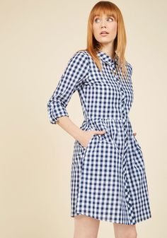 <p>Whether it's aged wine, IPAs, or appetizers you're savoring, this gingham dress will guarantee you do it in good taste! Part of our ModCloth namesake label, this cotton button up has detectable notes of timelessness with its white-and-navy color scheme, tab sleeves, and hidden pockets.</p>