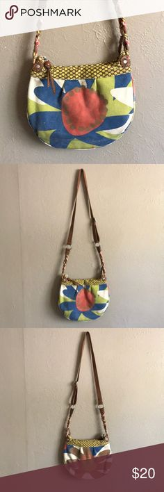 Fossil Canvas Printed Crossbody Great earthy tones in this canvas Crossbody with genuine leather accents. Silver toned hardware. No sign of wear. Interior has two slip and one zip pocket. Open to offers Fossil Bags Crossbody Bags