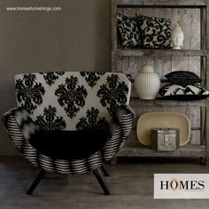 Feel at ease with yourself amidst a comfortable black and white upholstered chair with matching cushions of the same colours. Just beat the stress! It's your day. Explore more @ www.homesfurnishings.com #HomesFurnishings #HomeDecor #HomeFabrics #Furnishings #HomeInteriors