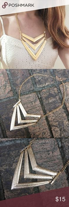 🎈VS!🎈Gold Statement Necklace This gorgeous statement necklace is the perfect addition to any outfit. It is comprised of three triangles with bars on the side. From the top of the bar to the very bottom of the last triangle, it is 4.5 inches. If you have any questions let me know. With ❤️️, L. (Not real gold) Jewelry Necklaces