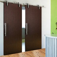 This European Modern Sliding Wood Standard Double Barn Door Hardware Kit series offers a wide variety of styles to complement any living space. The hardware combines contemporary design with European style to bring warmth and elegance to doorways. Sliding doors provide an innovative solution for closed off rooms or tight spaces in any home or office. Modern Sliding Doors, Double Barn Doors, Barnyard Door, Bypass Barn Door Hardware, Wood Barn Door, Pivot Doors, Industrial, Swinging Doors, Interior Barn Doors