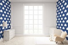 Child's room with cloud wallpaper on dark blue wall