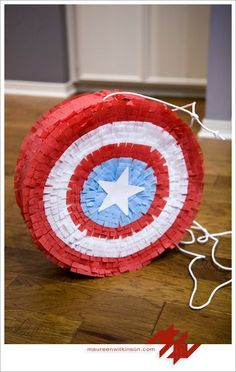 Broox's birthday party was Captain America themed, and considering he wanted to have it at the house, I wanted to find a piñata for it. Well, I couldn't. I only found an Avengers one at a local party store for $19.99 and it wasn't cute. Then I checked online and found a Captain America shield…