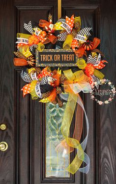 A personal favorite from my Etsy shop https://www.etsy.com/listing/452712890/halloween-wreath-candy-corn-halloween