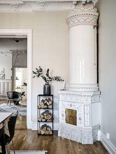 A kakelugn / masonry oven in a stunning Swedish space in white - stadshem.